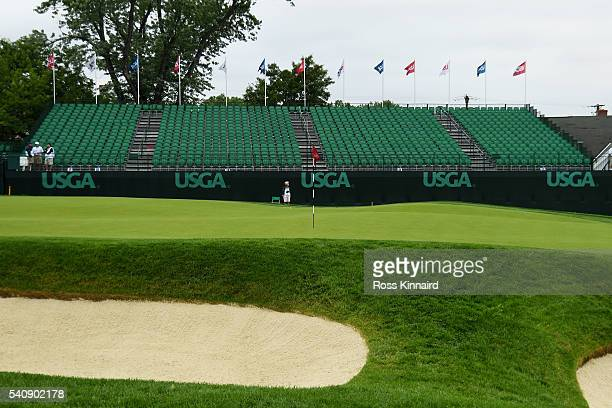 Empty grandstands are seen near the 18th green during the continuation of the weather delayed first round of the U.S. Open at Oakmont Country Club on...