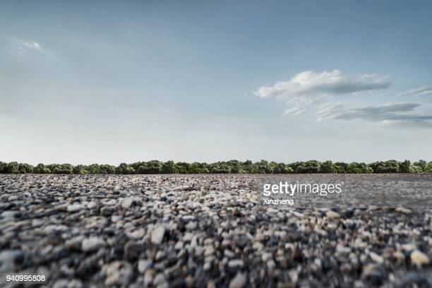 empty gravel parking lot - low angle view stock pictures, royalty-free photos & images