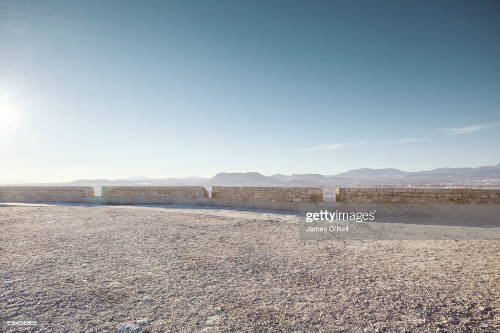 Empty gravel plateau with distant mountains for automotive placement : Stock Photo