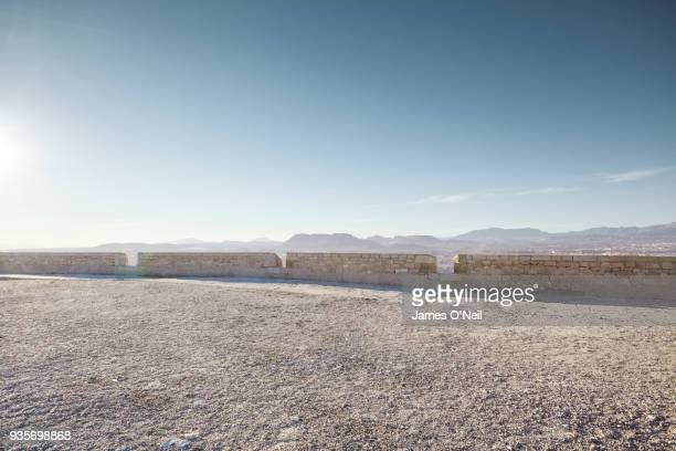 empty gravel plateau with distant mountains for automotive placement - gravel stock pictures, royalty-free photos & images