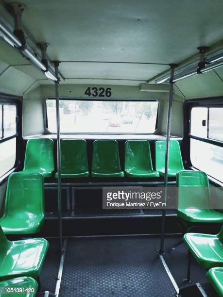 empty green seats in bus - seat stock pictures, royalty-free photos & images