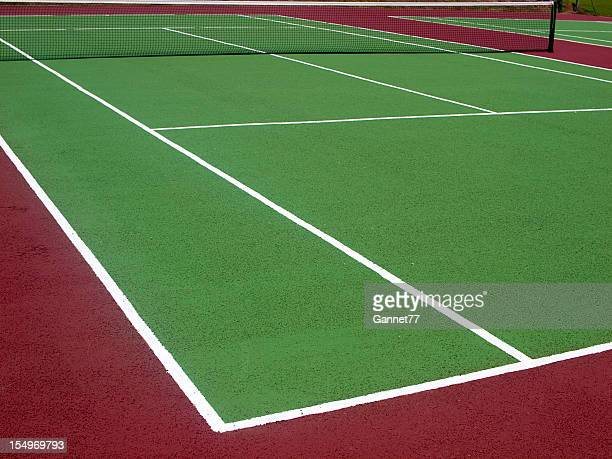empty green tennis court with net - hardcourt stock photos and pictures