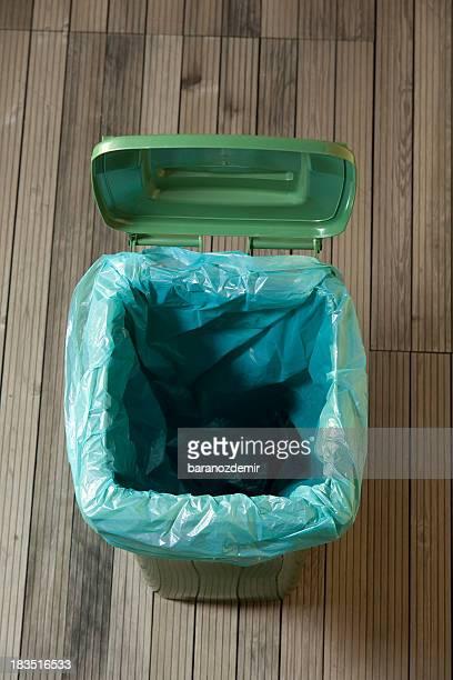 empty green trash can