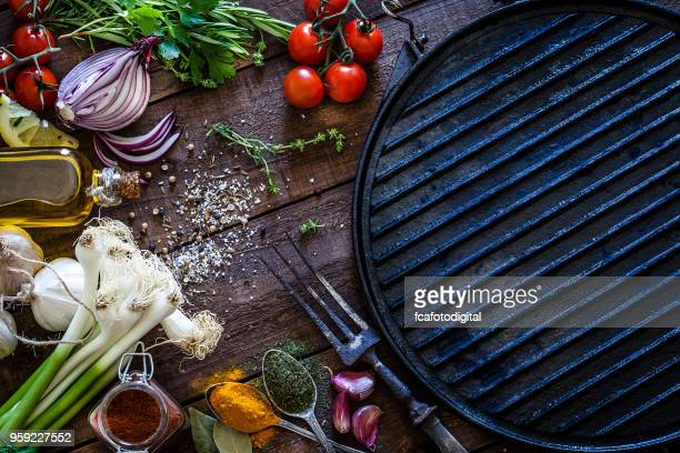empty griddle and ingredients for cooking - grill concept stock photos and pictures