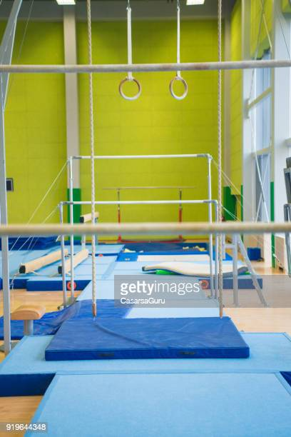 empty gym with gymnastics equipment - horizontal bars stock pictures, royalty-free photos & images
