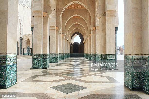 empty hallway in mosque hassan ii - mosque hassan ii stock photos and pictures