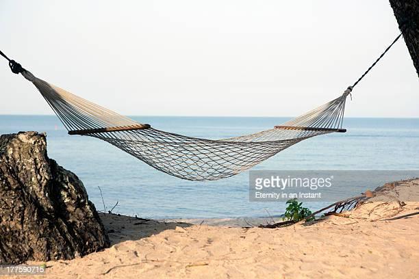 Empty hammock by the sea