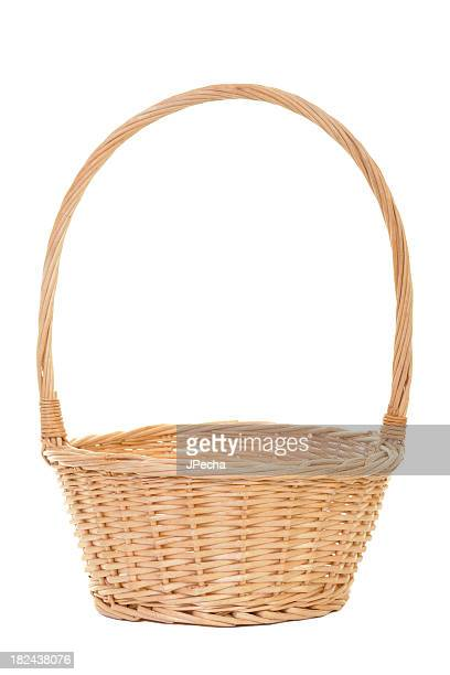 Empty handmade wicker basket on white background