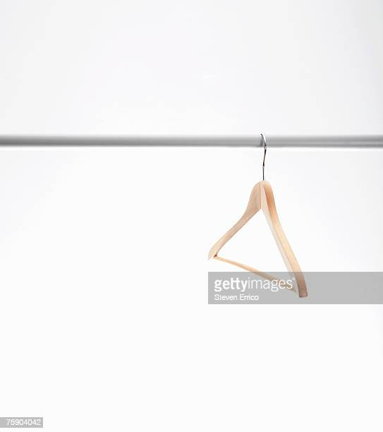 Empty hanger hanging on clothes rack