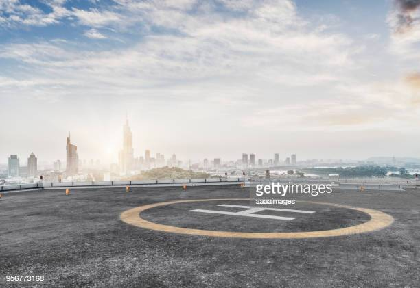 empty helicopter parking in nanjing city - helipad stock photos and pictures