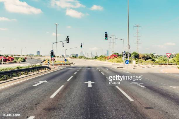 empty highway against sky - road signal stock pictures, royalty-free photos & images