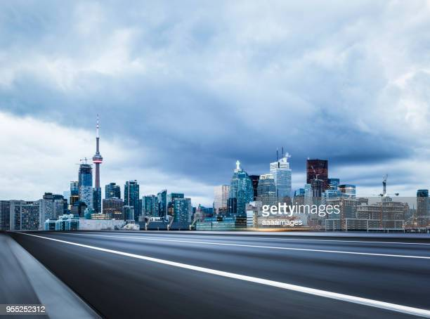 empty highway travel through toronto city,ontario - north america stock pictures, royalty-free photos & images