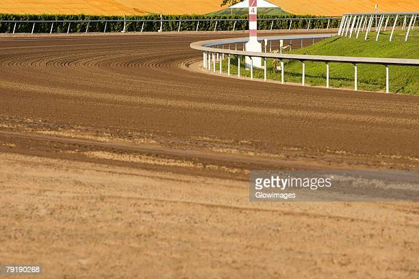 empty horseracing track in a stadium - horse racecourse stock photos and pictures