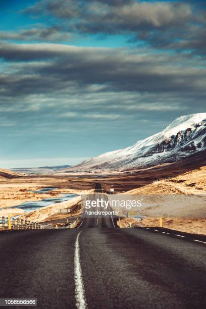 empty icelandic road - westfjords iceland stock photos and pictures