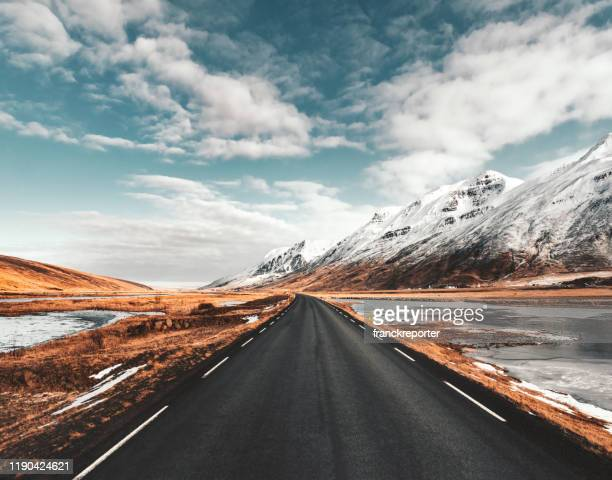 empty icelandic road - polar stock pictures, royalty-free photos & images