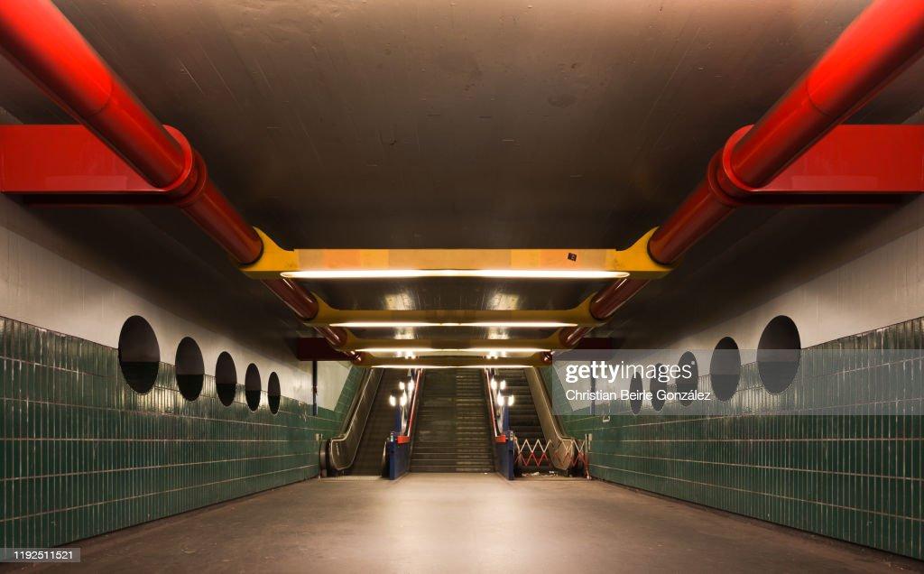 Empty Illuminated Corridor of Berlin subway station Schloßstraße : Stock Photo