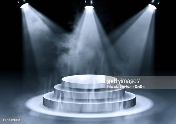 empty illuminated stage at night - spotlight stock pictures, royalty-free photos & images