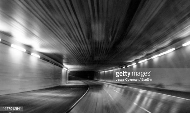 empty illuminated tunnel - jesse coleman stock pictures, royalty-free photos & images