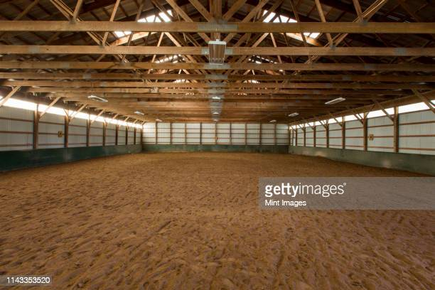 empty indoor horse riding ring - ranch stock pictures, royalty-free photos & images