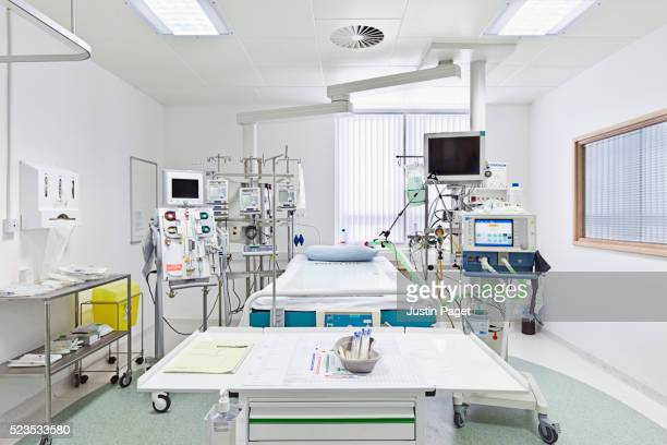 empty intensive care bed in uk hospital - intensive care unit stock pictures, royalty-free photos & images
