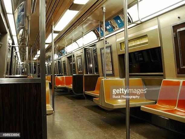 Empty interior of New York City subway car