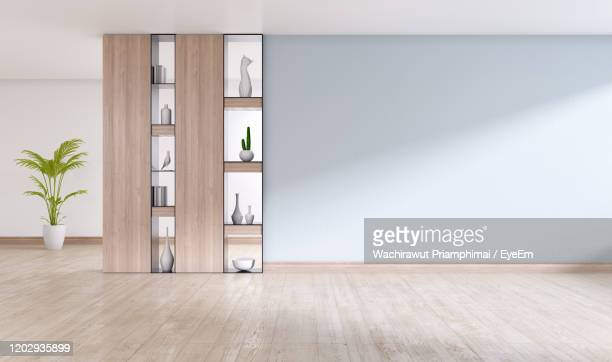 empty interior room ,gray wall with wood shelf and engineered wood flooring ,3d rendering - domestic room stock pictures, royalty-free photos & images