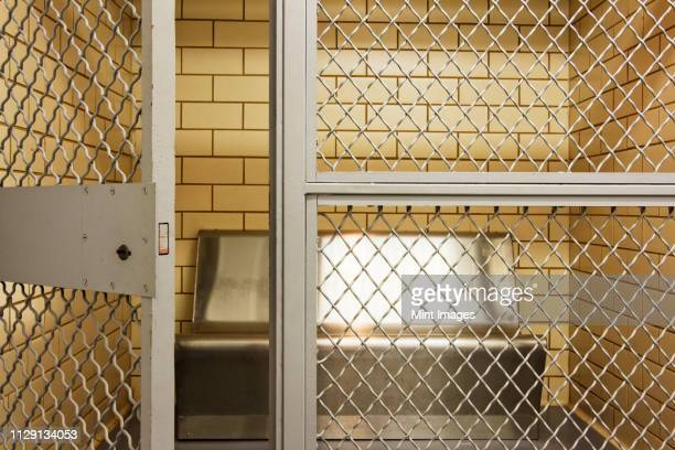 empty jail holding cell - releasing stock pictures, royalty-free photos & images