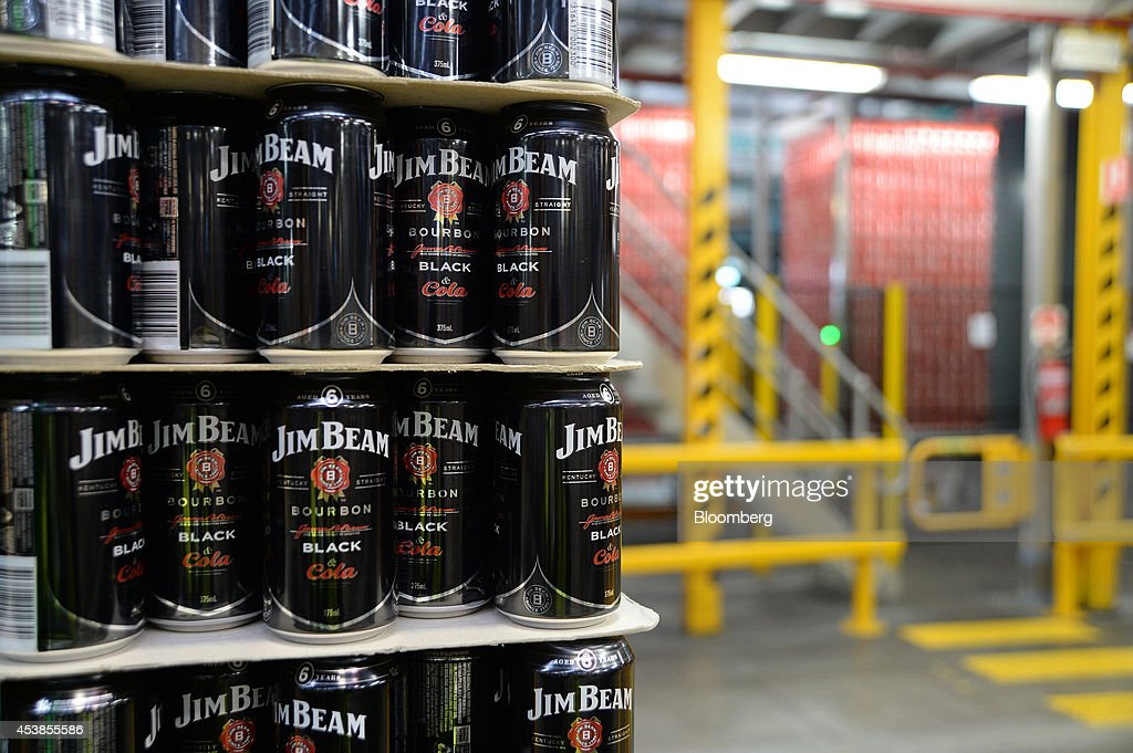 Empty Jim Beam Black & Cola cans stand ready for filling at a Coca-Cola Amatil Ltd. production facility in Melbourne, Australia, on Tuesday, Aug. 19, 2014. Coca-Cola Amatil flagged a second consecutive drop in full-year earnings amid weak consumer confidence and rising costs in Indonesia. Photographer: Carla Gottgens/Bloomberg via Getty Images