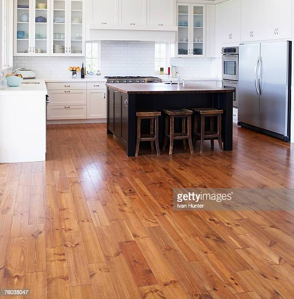 empty kitchen in contemporary house - wooden floor stock pictures, royalty-free photos & images