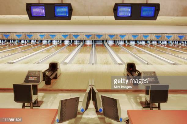 empty lanes in bowling alley - ボーリング場 ストックフォトと画像
