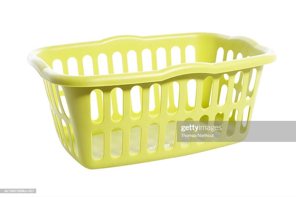 Empty laundry basket on white background : Stock Photo
