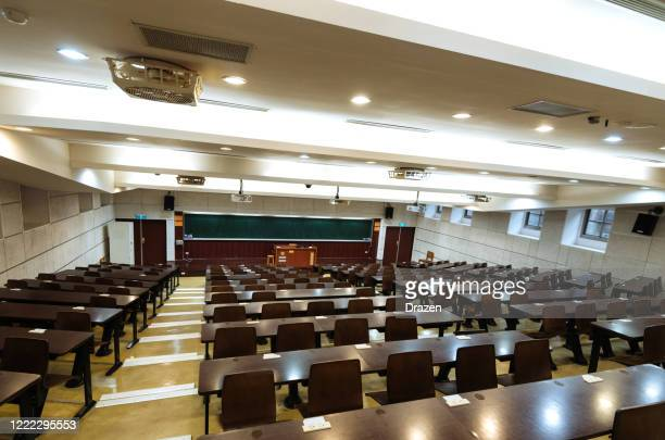 empty lecture hall during coronavirus pandemic - epidemic stock pictures, royalty-free photos & images