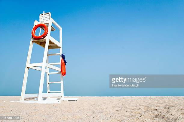 empty lifeguard chair on the beach - lifeguard stock pictures, royalty-free photos & images