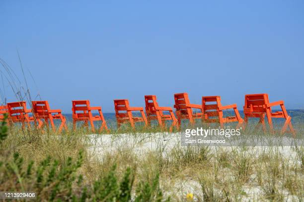 Empty lifeguard chairs are seen at Jacksonville Beach amid the coronavirus outbreak on March 21 2020 in Jacksonville Beach Florida Jacksonville Mayor...