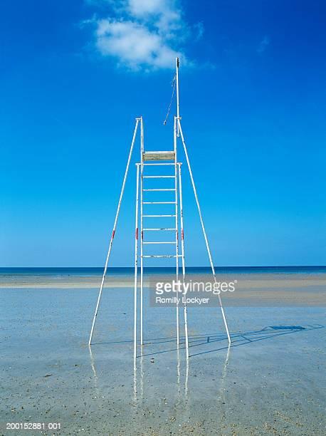 Empty lifeguard tower on beach