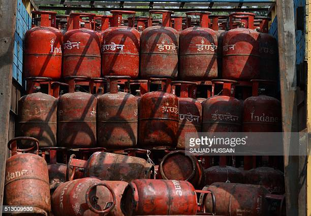 Empty Liquid Petroleum Gas cylinders stand on a truck outside a depot in New Delhi on February 29 2016 In his budget statement India's Finance...