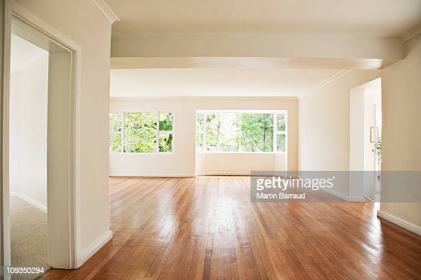empty living room with white walls - wooden floor stock pictures, royalty-free photos & images