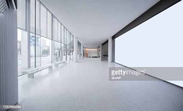 empty long passageway in modern building - ロビー ストックフォトと画像