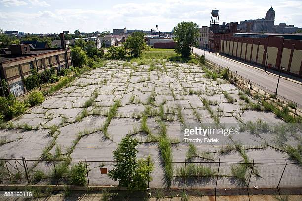 Empty lot overgrown with weeds The decadeslong decline of the US automobile industry is acutely reflected in the urban decay of Detroit the city once...