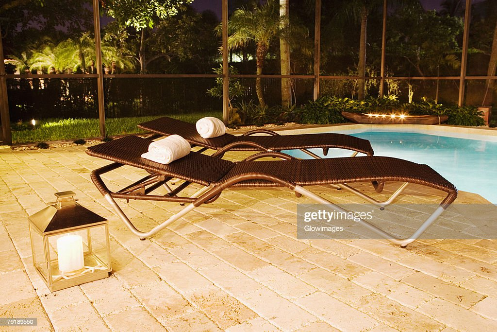 Empty lounge chairs at the poolside : Foto de stock