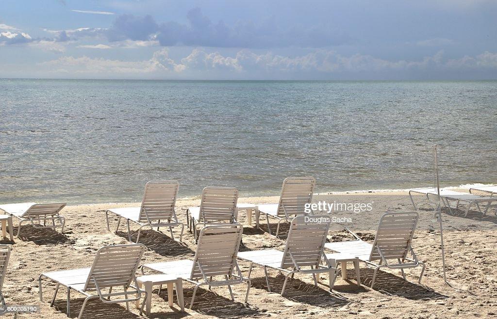 Empty lounge chairs on the tropical beach, Honeymoon Island State Park, Dunedin, Florida, USA : Stock Photo