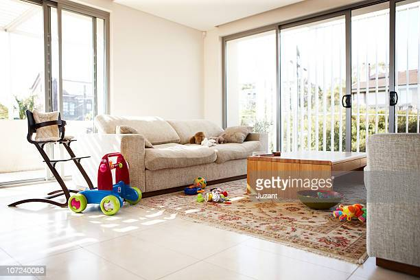 Empty lounge room with scattered toys