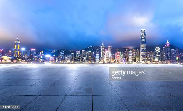 empty marble floor with cityscape of Hong Kong and illuminated skyline