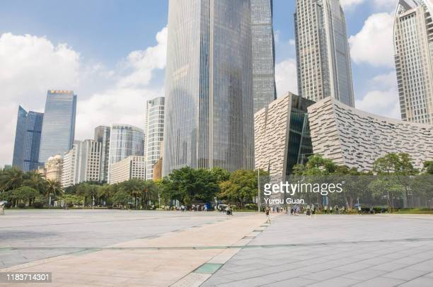 empty marble ground with guangzhou modern skyscraper in guangzhou cbd, china. - midday stock pictures, royalty-free photos & images