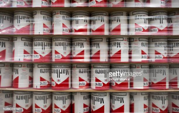 Empty Marlboro boxes stand on paletts in a storeroom of the f6 cigarette factory in Dresden Germany 22 January 2014 Photo Arno Burgi | usage worldwide