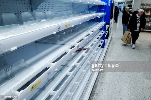 Empty meat shelves stripped through panic buying are seen in a branch of supermarket chain Sainsbury's on Tottenham Court Road in London England on...