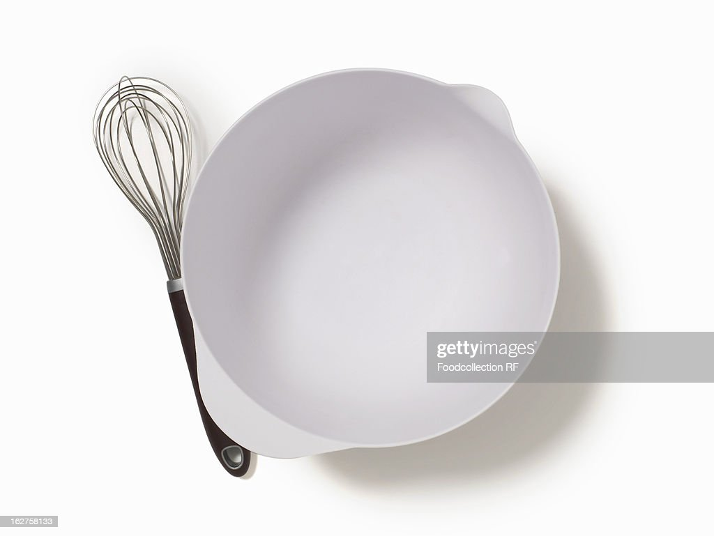 Empty mixing bowl and wire whisk : Stock Photo