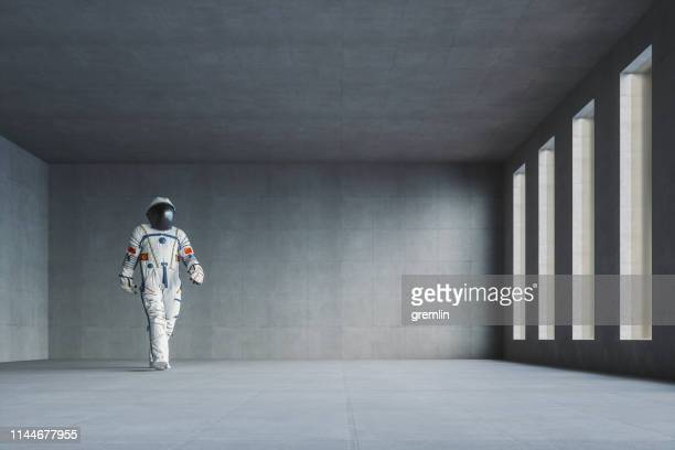 empty modern concrete office with walking spaceman - sparse stock pictures, royalty-free photos & images