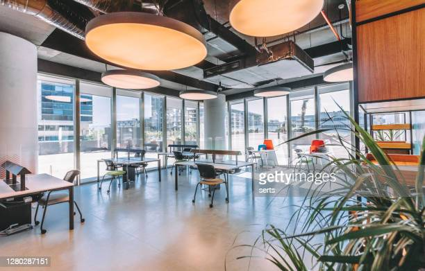 empty modern office room with working desks - office block exterior stock pictures, royalty-free photos & images