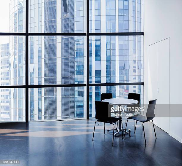 Empty modern office with table and four chairs